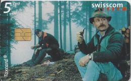 Telefoonkaart - Zwitserland. Swiss Telecom. Taxcard. CHF 5. Forstarbeiter, Schattdorf. foto: Julian Salinas.