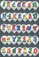 1123 A - Alphabet (lettres et chiffres) - Serie complete de 35 opercules Suisse Emmi