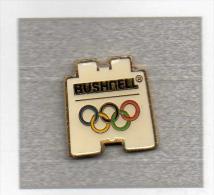 Pin´s  Sports  J.O   Avec  Sponsor  BUSHNELL - Juegos Olímpicos