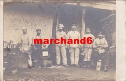 carte photo  militaire cuisine celui a droite on lit sur la casquette 33 donc 33eme artillerie ou infanterie !! a trouv�