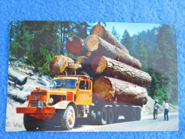 Logging Truck. One Of The Most Thrilling Sights In The West Is These Large Diesel Trucks Hauling Logs On Mountain Roads. - Non Classés