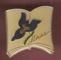 41379-Pin's.l'Union Nationale du Sport Scolaire .fleur pens�e.livre...