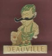 41666-Pin's.Deauville.Bià ¨re.Moustache.signé La Cadotiere.. - Villes