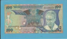 TANZANIA - 100 SHILINGI - ND ( 1985 ) - P 11 - Sign. 3 - Serie EC - Julius Nyerere / Procession - BENKI KUU YA - Tanzanie