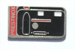 Pin's  PRESTINOX - Appareil Photo Compact - CEM - E026 - Photography