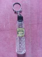 Porte Clef Pour Parfum En Verre Blanc Et Bouchon Plastique étiquette Marqué PARFUMS CORANIA LILAS MARSEILLE - Key-rings