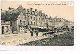 CPA (14) LUC-SUR-MER - Rue Du Grand-Orient -Animée-Voitures (040) - Luc Sur Mer