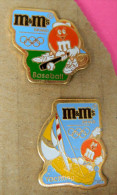 2 Pin´s - M & M´s Brand - Jeux Olympiques - Baseball - Yachting - Marques