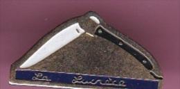 43984-Pin's.Ancien Couteau Laguiole Lucrece - Marques