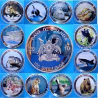 UGANDA 12X100 S 2010 ARGENTO PROOF MAN EATERS PESO 49,6gX12 SILVER PLATED CONSERVAZIONE FONDO SPECCHIO UNC. - Ouganda