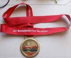 ITALIA - MEDAGLIA UFFICIALE DELLA 41^ ROMAOSTIA HALF MARATHON - Atletica