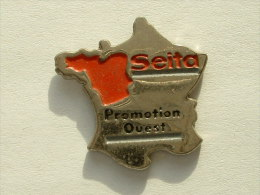 Pin´s CARTE DE FRANCE - SEITA PROMOTION OUEST - Villes