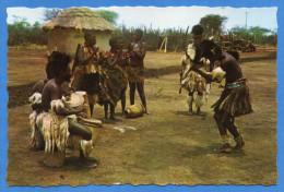 Afrika; African Village Scene - Dancing Is An Integral Part Of The Villagers Way Of Life - Ansichtskarten