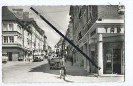 CPSM -  Lisieux - Rue Henri Chéron - Nouvelles Constructions - Autos,voitures,autobus Ancien,anciennes - Lisieux