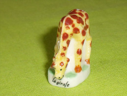 Fèves / Animaux :bébé Girafe   T61 - Animaux