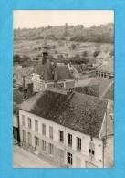 Carte Photo De Bury. - Au 1er Plan Le Grand Café Burysien Et La Graineterie Au Second Plan, La Mairie Et L'École. - Otros Municipios