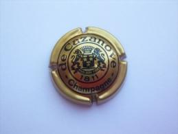 Capsule Plaque De Muselet Champagne De Cazanove - Or Et Noir - De Cazanove