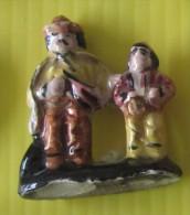 F�ve - Santon de cr�che filet or . Le vieil homme et l' enfant