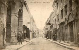 CPA LA TOUR DU PIN   Rue D'Italie. Commerces, Pub L'aigle Assurances, Byrrh. 1904 - La Tour-du-Pin