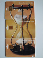 PHONECARDS from FINLAND - PUZZLE - HOUR GLASS - with CHIP