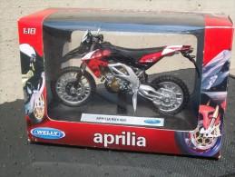 WELLY - APRILIA RXV 450  AVEC SA BOITE Scala 1/18 - Motos