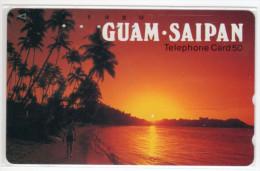 GUAM  TELECARTE JAPONAISE PALMIER COUCHER DE SOLEIL - Guam