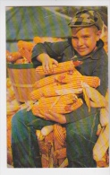 boy showing off Iowa Corn