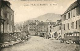LA CANOURGUE LA PLACE HOTEL DU COMMERCE ET AUTOBUS - Frankreich