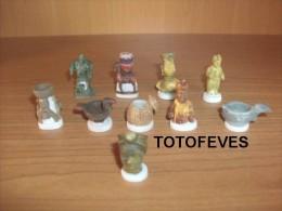SERIE COMPLETE LES ARTS PRIMITIFS DE 10 FEVES PERSO N° 227 - Sorpresine