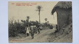 GUINEE Afrique TIMBO 22 Une RUE Village Occidentale Homme Enfant CPA Animee Postcard - Guinée