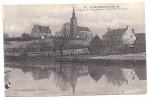 CPA Saint Momelinl Nord 59 Eglise Et Presbytère Vue Prise Du Canal Meule De Foin édit Baurain à St Omer N°62 - Other Municipalities