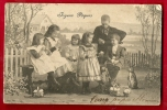 FXI-09  Joyeuses Pâques  Famille Avec Lapin Et Oeufs. Précurseur. Circulé Sous Enveloppe - Pâques