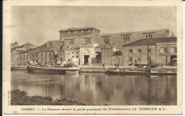 COGNAC , La Charente Devant La Partie Principale Des Etablissements JAs HENNESSY & C° , CPA ANIMEE - Cognac