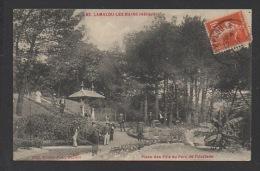 DF / 34  HERAULT / LAMALOU LES BAINS / PLACE DES PINS AU PARC DE L'USCLADE / ANIMÉE / CIRCULÉE EN 1915 - Lamalou Les Bains