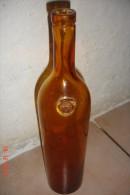 Bouteille Xixèverre Verre Jaune. ,Vodka WK Tomsk..H:34 Cms ,D:7 Cms. - Autres Collections
