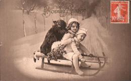 CARTE DE BONNE ANNEE DEUX ENFANTS ET UN CHIEN SUR UNE LUGE CIRCULEE LE 11/1/1914 - New Year