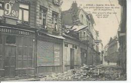 12 -ARRAS - CETTE PETITE EPICERIE RECUT UN OBUS QUI LA SUPPRIMA ( PHARMACIE ) - Arras