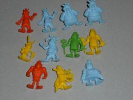 Rare Lot De 11 Figurines En Plastique Monochrome, MALABAR, Obélix Astérix, Assurancetourix, Uderzo Goscinny Chewing Gum - Asterix & Obelix