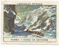CHROMOS PUPIER - AMERIQUE DU NORD - ALASKA - DEFILE DE KEYSTONE - Chocolat