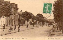 CPA - SANNOIS (95) - Aspect De La Rue De Paris En 1915 - Au 1° Plan Une Voiturette D'enfant - Sannois