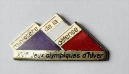 Pin's Ministère De La Défense XVI Jeu Olympiques D'hiver - 30R - Pin's