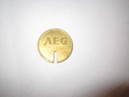 ----------1 JETON--- AEG----wertmarke-fur-munzzahler-------------- - Jetons En Medailles