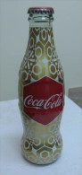 AC - COCA COLA - SHRINK WRAPPED EMPTY GLASS BOTTLE 2010 - Bouteilles