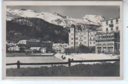 Suisse - St Saint Moritz Bad. - Animé Vue De La Patinoire Et Des Hôtels  Au Loin Montagnes Enneigée - CP Glacée - GR Grisons