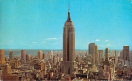 UPTOWN SKYLINE SHOWING EMPIRE STATE BLDG AND R.C.A BLDG / NEW YORK CITY - New York City