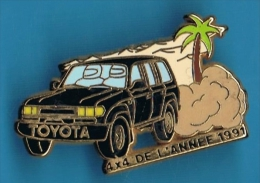 PIN´S //  ** TOYOTA ** 4 X 4  DE L´ANNÉE ** 1991 ** . (Arthus Bertrand Paris) - Toyota