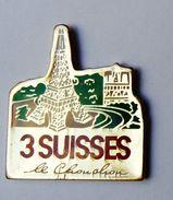 Pin's Les 3 Suisses Le Chouchou Tour Eiffel - 30R - Pin's