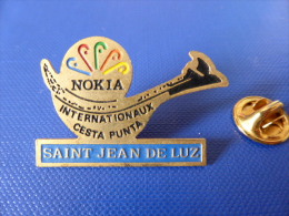 Pin's Pelote Basque - Chistera - Saint Jean De Luz - Internationaux Cesta Punta - Nokia (PU58) - Badges