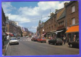 Carte Postale 50. Mortain La Rue Principale Voitures  Trés Beau Plan - Autres Communes