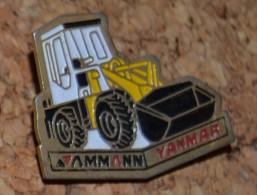 Pin's ENGIN DE CHANTIER  TRACTOPELLE CHARGEUR   TP    YANMAR Yanmar Construction Equipment Europe P48 - Pin's